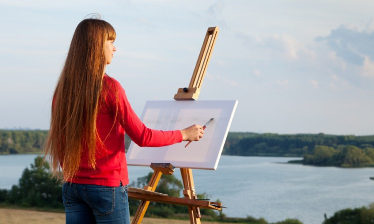 artist painting an sea landscape